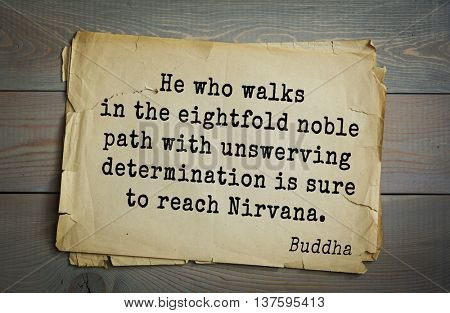 Buddha quote on old paper background. He who walks in the eightfold noble path with unswerving determination is sure to reach Nirvana.