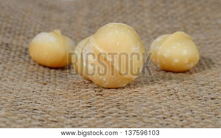 Macadamia sackcloth brown background , Focus macadamia front.