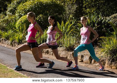 Young athlete women exercising in park