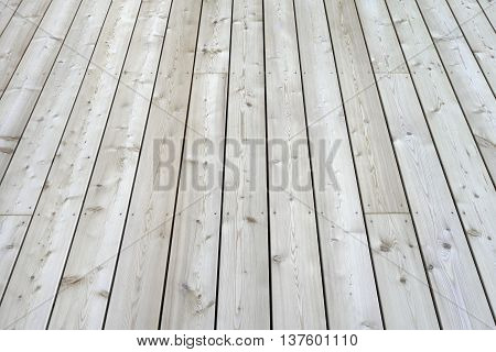 Section of a simple new terrace floor built of wooden planks.