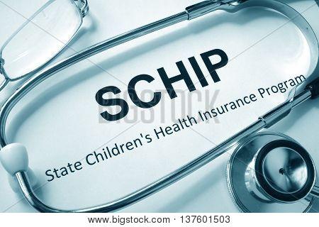 Paper with words SCHIP State Children's Health Insurance Program.
