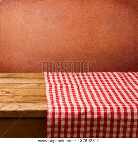 Retro background with tablecloth and red wall