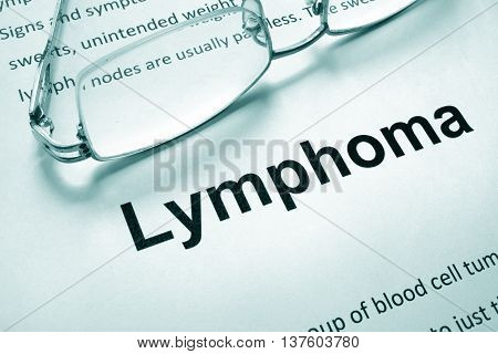 Paper with word lymphoma and glasses. Medical concept.