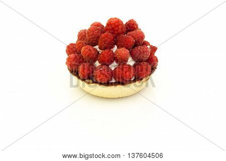 Tartlet pastry with cream and fresh raspberries on white background.