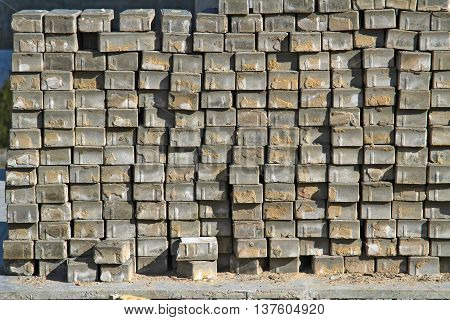 Grey paving tiles composed of a hill in the open air (background texture)