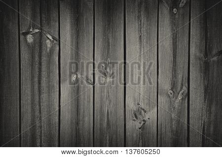 A dark wooden wall with spotlight as a background