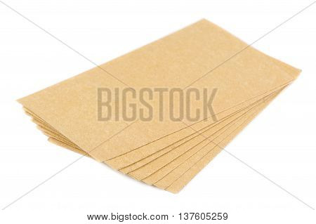 A pile of mustard plasters isolated on a white background