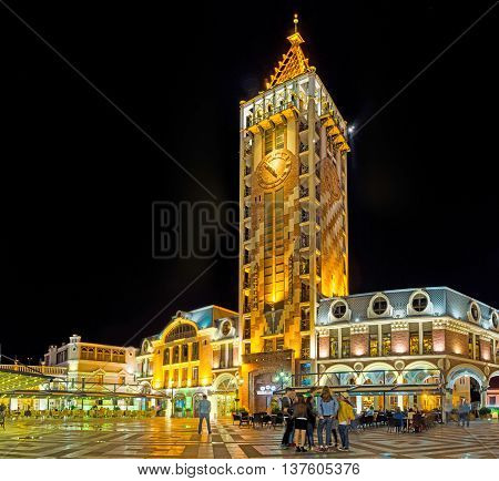 BATUMI GEORGIA - MAY 24 2016: The high clock tower of Piazza Inn located on the Piazza Square and surrounded by outdoor cafes and souvenir shops on May 24 in Batumi.