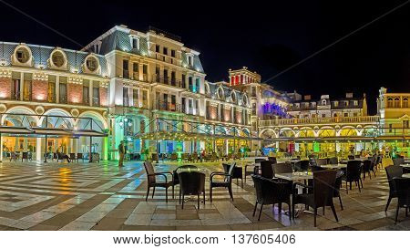 BATUMI GEORGIA - MAY 24 2016: The outdoor cafe on Piazza Square surrounded by buildings of Piazza Inn art galleries and souvenir stores on May 24 in Batumi.