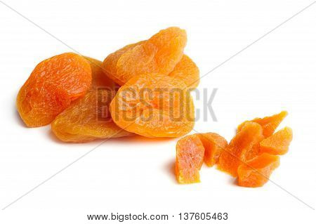A close-up of dried apricots isolated on a white background