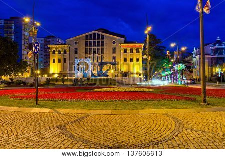 The evening view on Batumi Drama Theater with the large flower bed in the square in front of it Georgia.