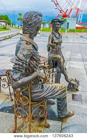BATUMI GEORGIA - MAY 24 2016: The lovely couple of the sculpture group Me You and Batumi drinks coffee in Miracle Park on May 24 in Batumi.
