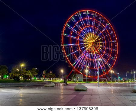 The colorful ferris wheel offers interesting adventures and amazing views on the evening Batumi Georgia.