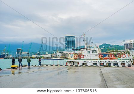 BATUMI GEORGIA - MAY 24 2016: The Sea Port overlooks the misty Lesser Caucasus mountains covered with forests and seaside city districts on May 24 in Batumi.