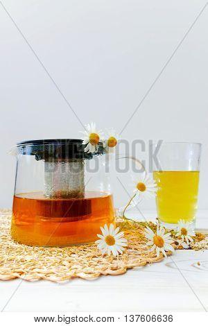 Healthy camomile herbal tea on white backgound