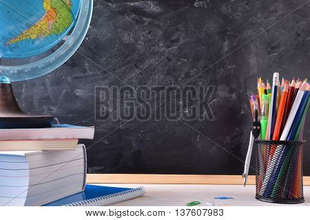 Writing Desk With School Tools And Blackboard