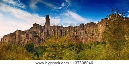 Pitigliano medieval village on tuff rocky hill. Panorama landscape high resolution photography. Italy, Europe.
