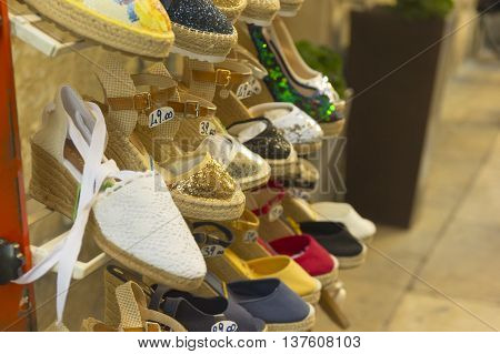 LECCE, ITALY - MAY 2016: Sale of shoes in the street