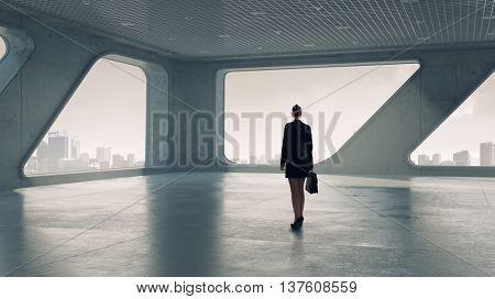 Businesswoman in building interior . Mixed media