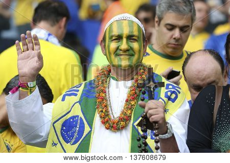 Belo Horizonte Brazil - july 08 2014: Fan with pops fantasy during the FIFA 2014 World Cup. Brazil is facing Germany in the semi-finals at Mineirao Stadium