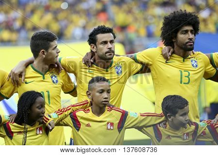 Belo Horizonte Brazil - july 08 2014: OSCAR FRED and DANTE of Brazil during the FIFA 2014 World Cup. Brazil is facing Germany in the semi-finals at Mineirao Stadium
