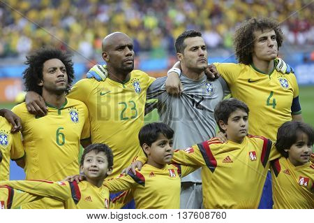 Belo Horizonte Brazil - july 08 2014: MARCELO MAICON JULIO CESAR and DAVID LUIZ of Brazil during the FIFA 2014 World Cup. Brazil is facing Germany in the semi-finals at Mineirao Stadium
