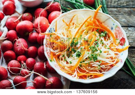 Cabbage Salad.  Cabbage Salad With Sweet Carrot, Radish, Bow In