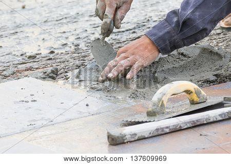 Mason Repairing The Tiles