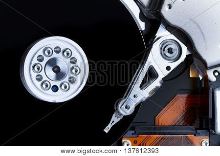Opened computer hard drive closeup top view photo