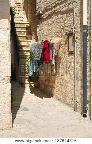 Characteristic alleyway of Giovinazzo. Puglia. Southern Italy.