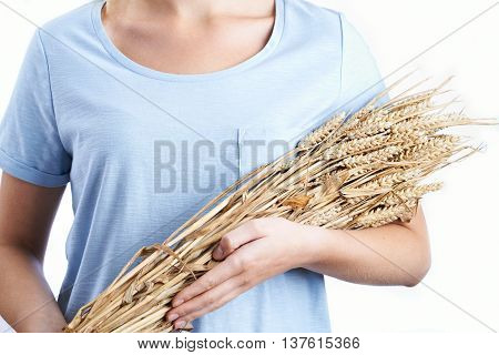 Close Up Of Woman Holding Bundle Of Wheat