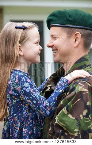 Soldier On Leave Hugging Daughter At Home
