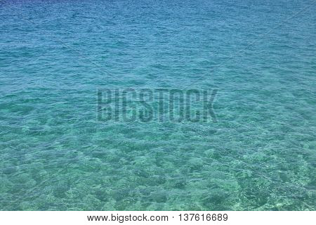 Blue sea water with waves and ripples. Sea background. Adriatic sea, Europe, Italy.