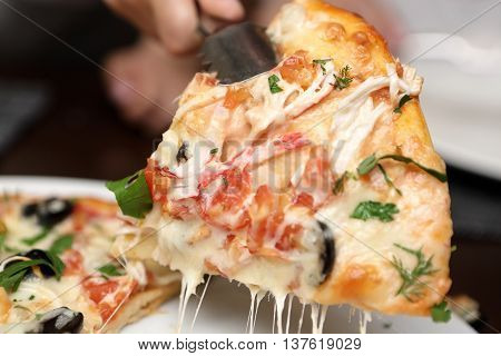 Person Takes Slice Of Pizza
