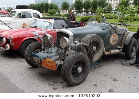PERM RUSSIA - JUNE 29: Rally of retro-cars Peking-Paris 2016 June 29 2016 in Perm Russia. Cars participating in the rally are near the hotel
