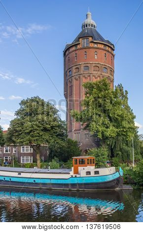 Old water tower at a canal in Groningen The Netherlands