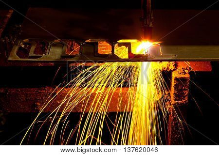 Laser Cutting Machine of metal sheet with sparks.