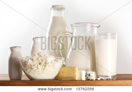 Different milk products: cheese, cream, milk, yoghurt. On a white background.