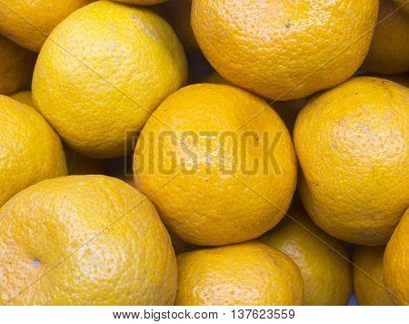 The many fresh raw orange has vitaminC for good health.