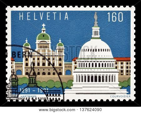 SWITZERLAND - CIRCA 1991 : Cancelled postage stamp printed by Switzerland, that shows Bern and Washington.