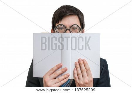 Young Shy Man Is Reading And Is Covering His Face And Is Hiding