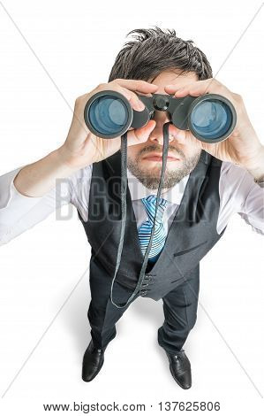 Top view on young man looking in binocular towards you. Isolated on white background.