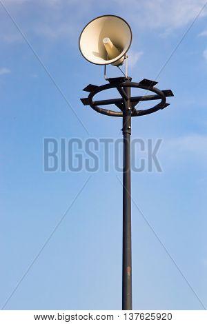 A megaphone blue sky background uprisen angle