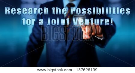 Enterprise manager is pressing Research the Possibilities for a Joint Venture! on a touch screen. Business objectives metaphor entrepreneurial spirit metaphor and call to action.