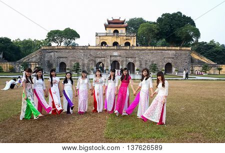 HA NOI, VIET NAM, March 18, 2016 a group of students, Ha Noi, traditional dress, playing outside, ruins, Hoang Thanh Thang Long, Ha Noi