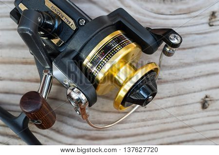 this is a fishing gear on wood background