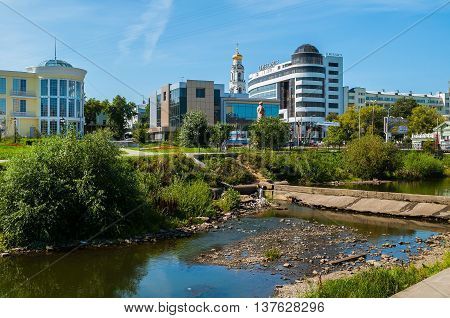 YEKATERINBURG RUSSIA - AUGUST 24 2013. Architecture landscape of Yekaterinburg - modern business and administrative buildings Great Zlatoust church and revolution monument near the city pond.