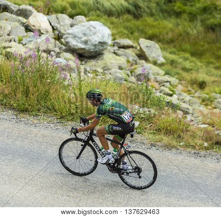 Col de la Croix de Fer France - 25 July 2015:The French cyclist Perrig Quemeneur of Europcar Team climbing to the Col de la Croix de Fer in Alps during the stage 20 of Le Tour de France 2015.