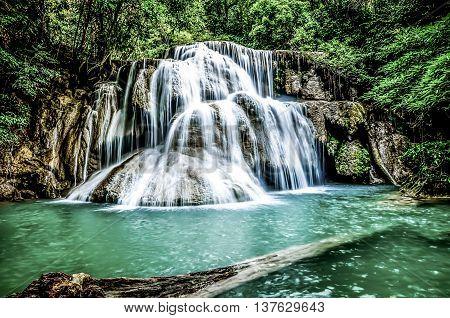 Nice waterfalls emerald green water in thailand.