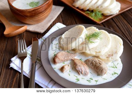 Turkey meat with dill sauce and bread dumpling